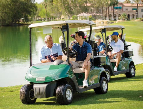 Foursome on the course in carts